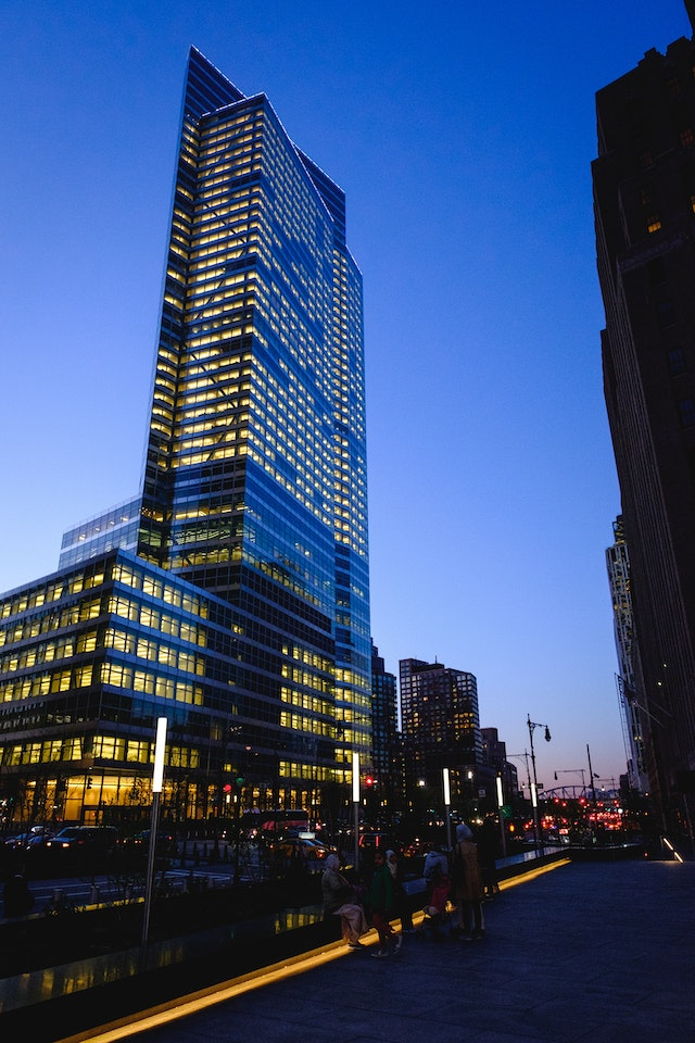 A building in the Financial District of New York, at dusk.