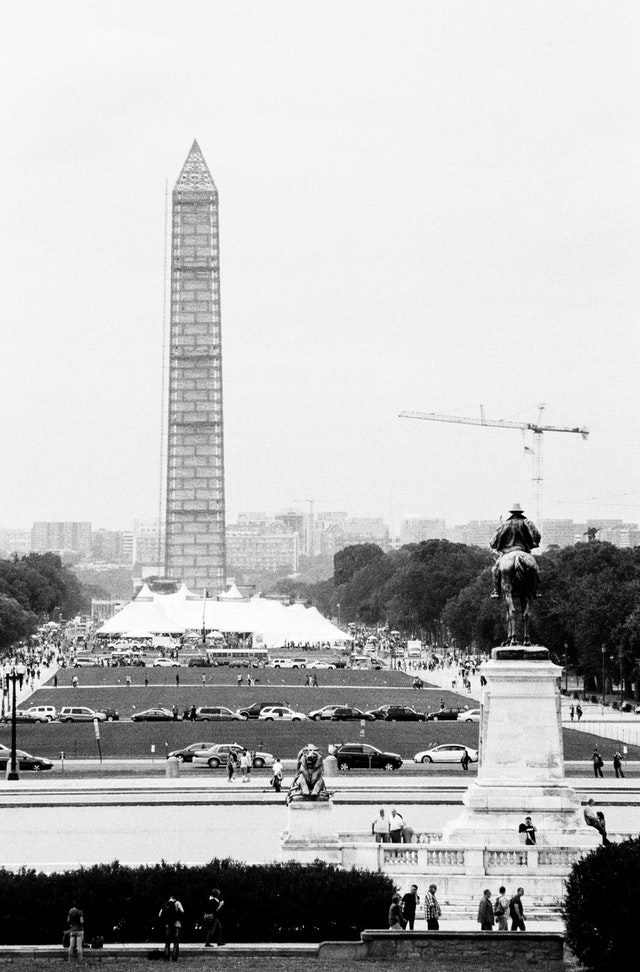 The National Mall, with the Washington Monument covered in scaffolding, from the West Front of the United States Capitol.
