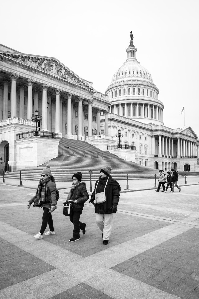 People walking in front of the United States Capitol.