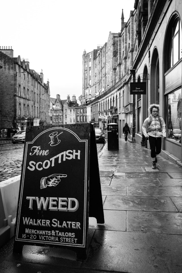 A store sign for a find Scottish tweet store on Victoria Street.