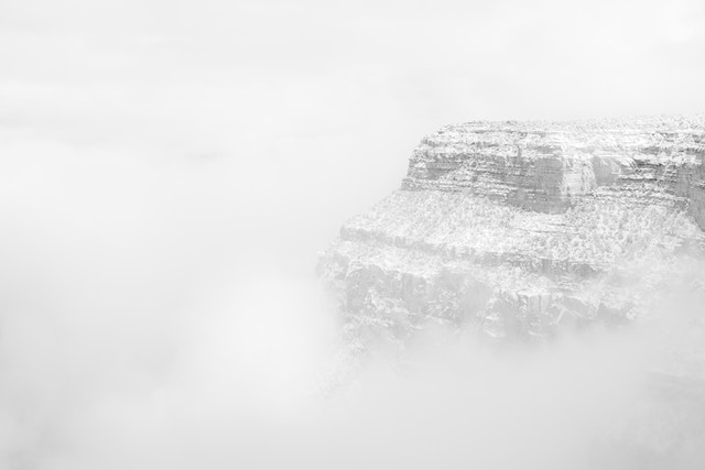 The South Rim near Yavapai Point peeking out of the fog during a snowstorm.