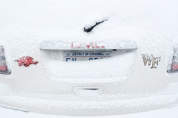 A snow-covered car.