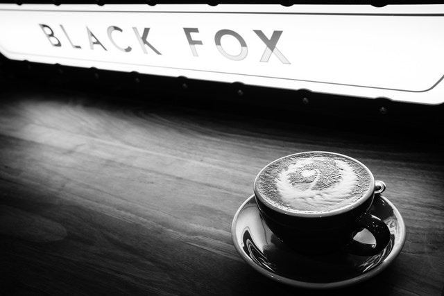 A cappuccino on the bar at the Black Fox coffee shop in New York City.