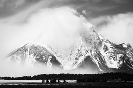 Mount Moran, shrouded in clouds and fog, seen from Willow Flats.