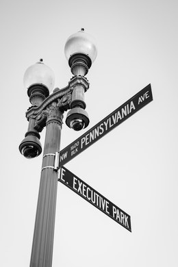 A street sign on Pennsylvania Avenue, in front of the White House.