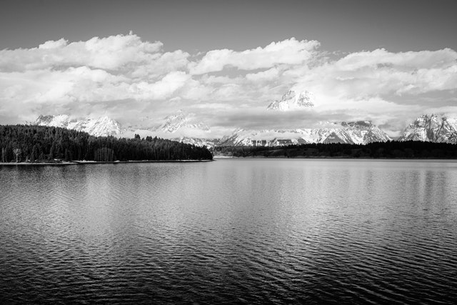 Jackson Lake, with Mount Moran and the Teton Range shrouded in clouds.