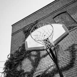 A basketball hoop next to an abandoned building in Chattanooga.