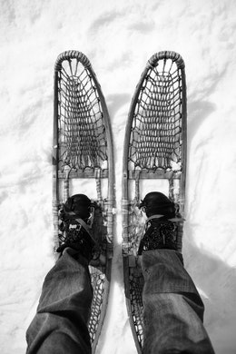 My feet, on ca. 1950 woven snowshoes.