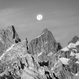 The moon, setting behind the cathedral group of the Tetons.