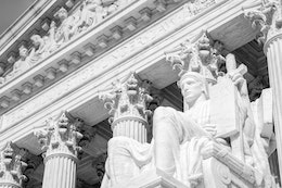 One of the statues in front of the United States Supreme Court.
