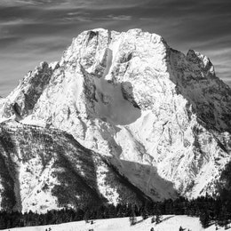 A close-up of a snow-covered Mount Moran in winter.