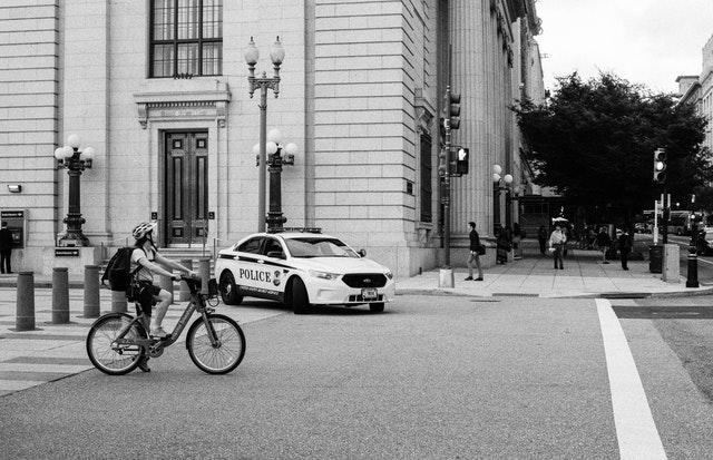 A cyclist waiting for the light to change on Pennsylvania Avenue, near the White House.