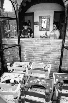 Two people preparing food at Fonda Carmelita in La Ciudadela, Mexico City.