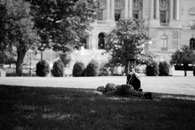 A man sleeping on the ground at the United States Capitol.
