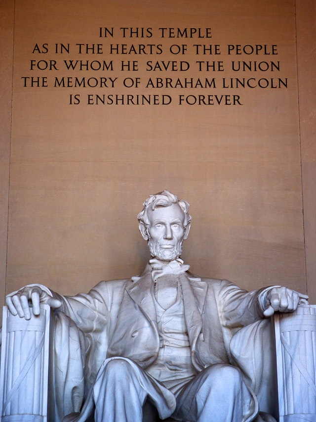 """The inscription above the statue of Lincoln at the Lincoln Memorial: """"In this temple, as in the hearts of the people for whom he saved the Union, the memory of Abraham Lincoln  is enshrined forever."""""""