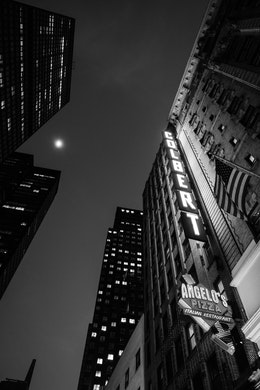 Looking up at the Colbert sign at the Ed Sullivan Theater, at night.