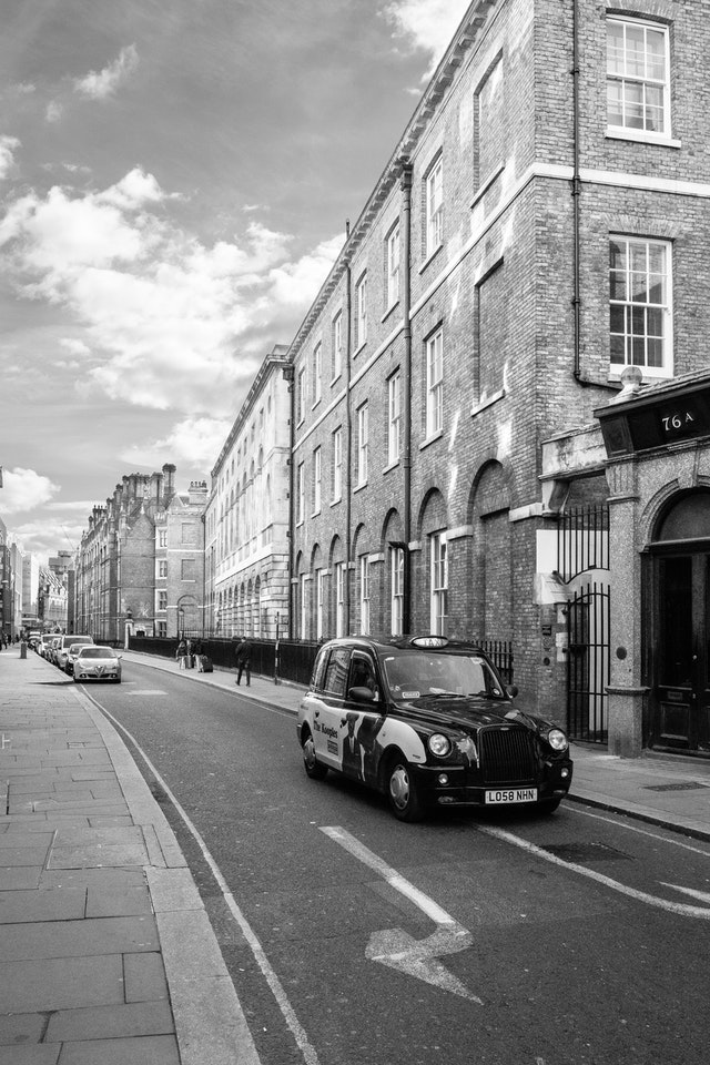 A taxi driving down Chancery Lane in London