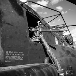 A minigun on the side of an MH-47G Chinook helicopter at the DC Armory.