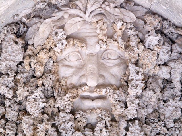 Creepy dude hiding behind the coral walls of a grotto in Vizcaya's gardens.