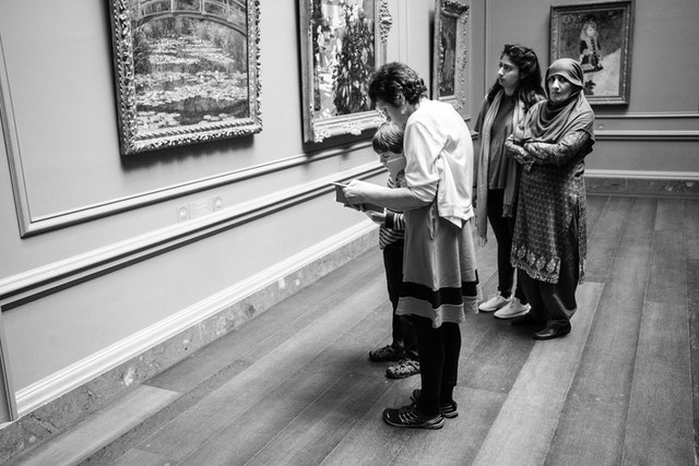 A group of people looking at artwork at the National Gallery of Art in Washington, DC.