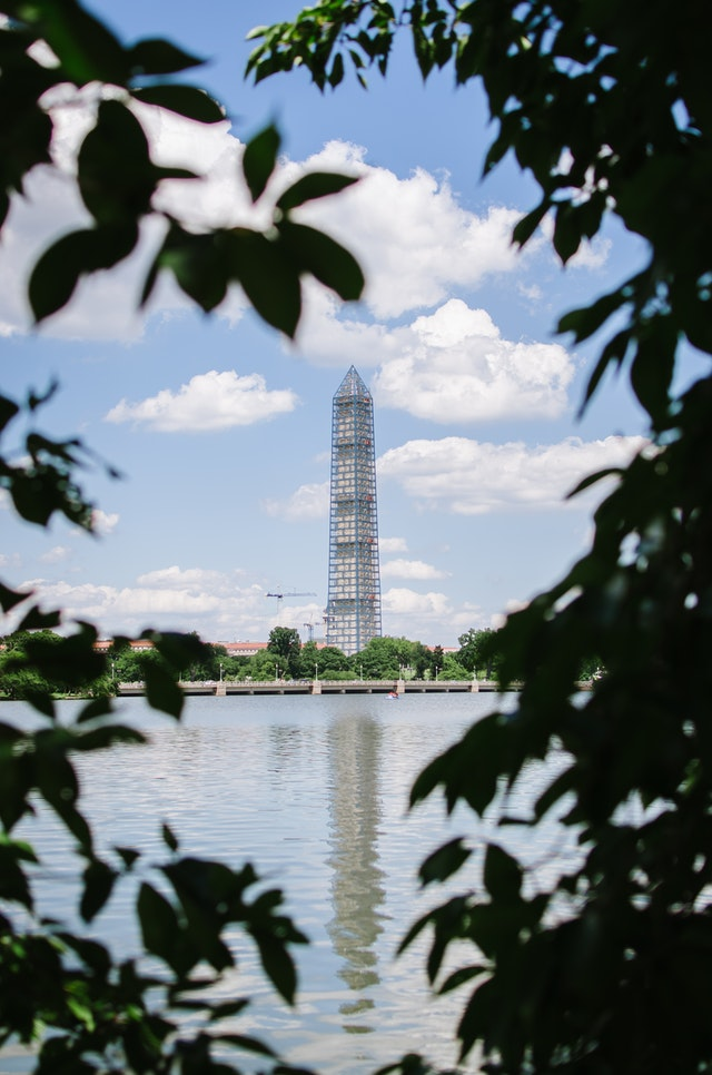 The Washington Monument covered in scaffolding, seen from across the Tidal Basin in Washington, DC.