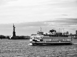 The Staten Island Ferry and the Statue of Liberty.