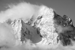 Close-up of Mount Moran's summit, shrouded in clouds.