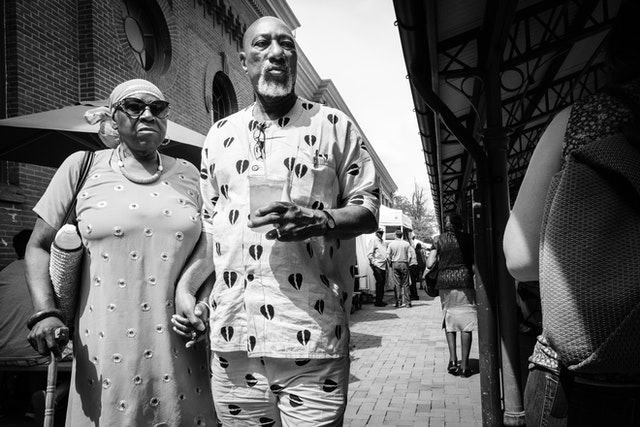 An older couple walking hand in hand at Eastern Market.