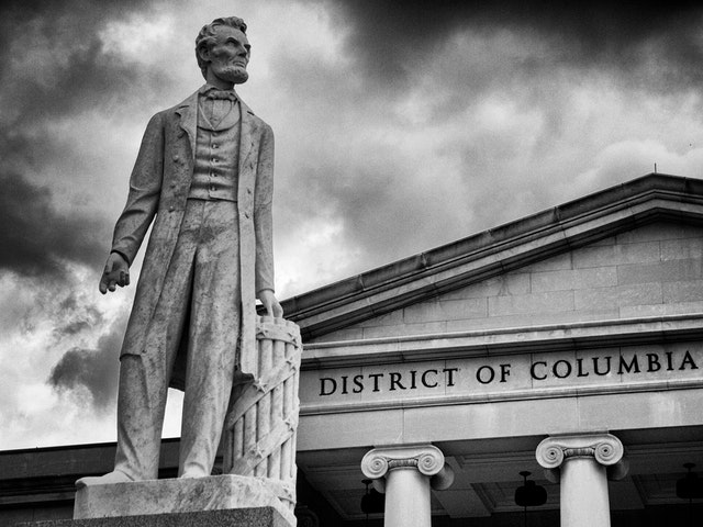 Statue of an evil-looking Abraham Lincoln in front of the DC Court of Appeals.