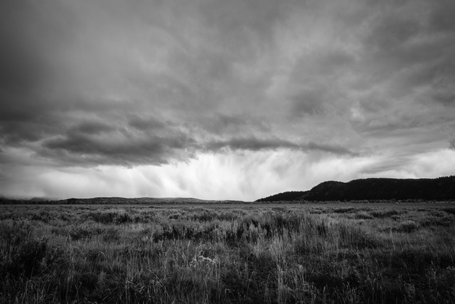 A storm dumping snow on Antelope Flats in Grand Teton National Park. Blacktail Butte can be seen to the right.