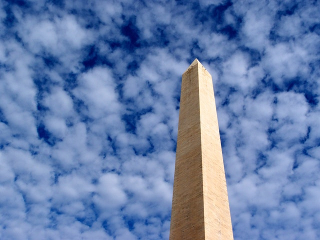 The Washington Monument surrounded by clouds.