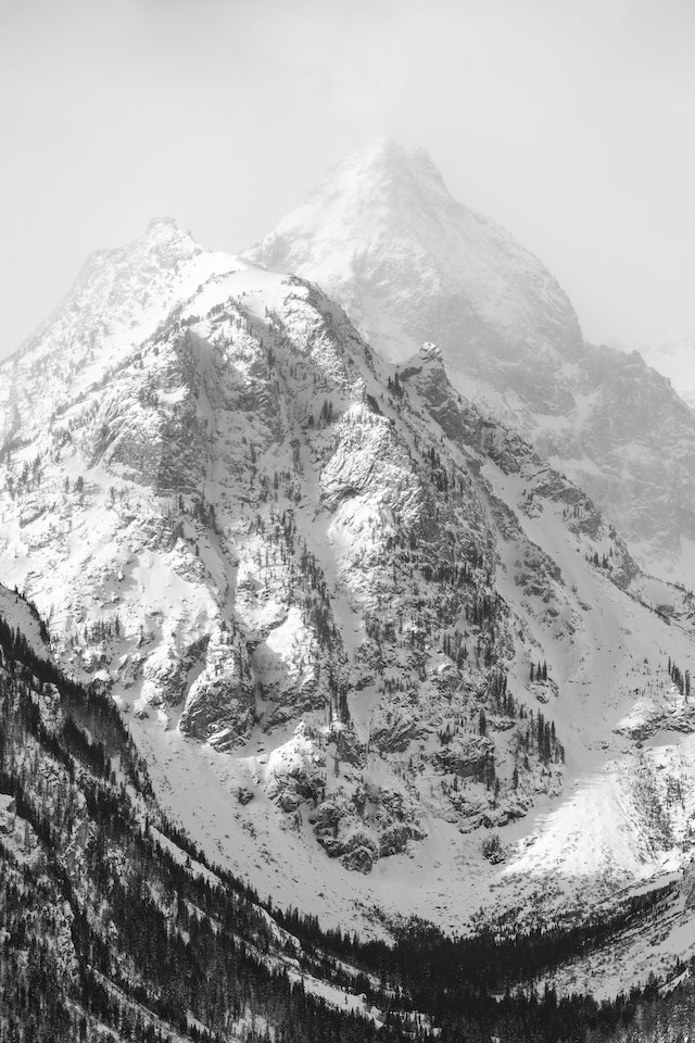 A couple of snow-covered peaks in the Teton Range, seen from the Teton Point Turnout.