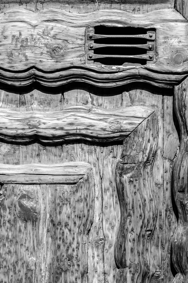 Detail of an old wooden door in the historic center of Mexico City.