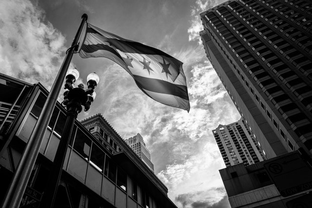 The Chicago flag flying in front of the State/Lake L station in Chicago.