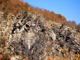 The fading advertisement for borated toilet powder in the cliff face of Maryland Heights, in Harpers Ferry.