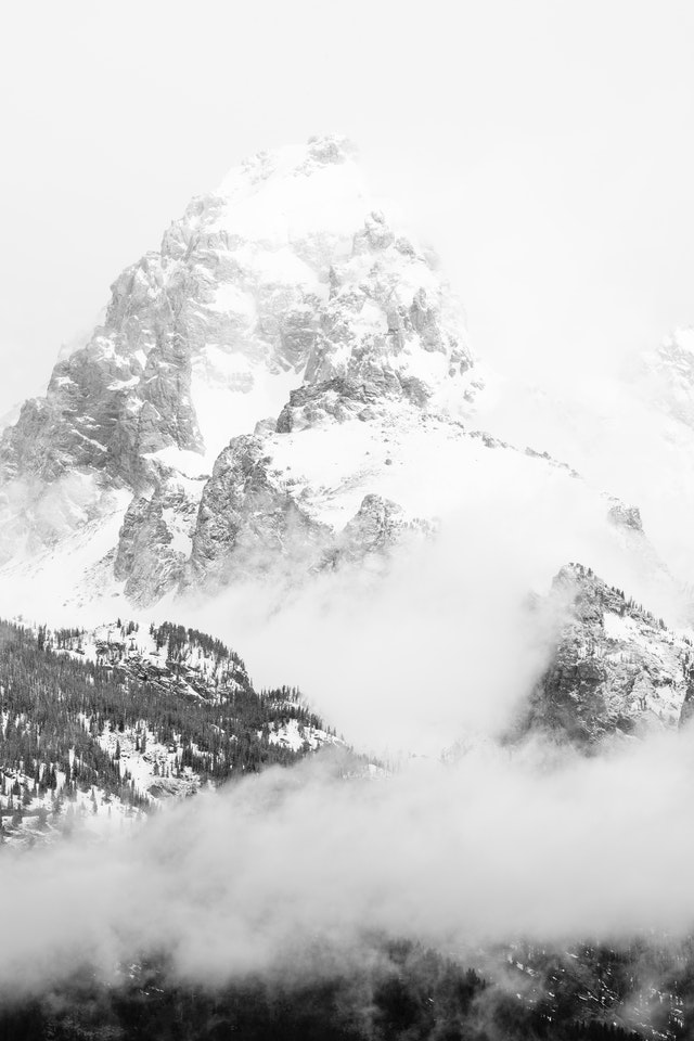 Grand Teton, partially covered in clouds and fog after a storm.