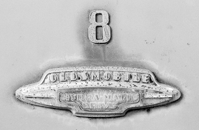 """The badge of an old Oldsmobile with """"hydramatic drive""""."""