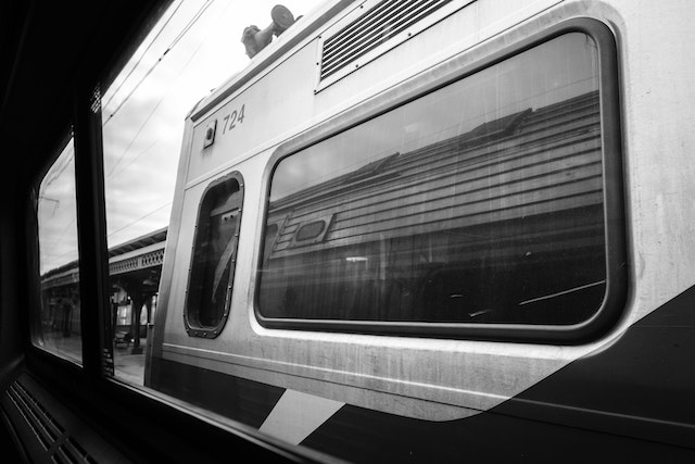 A train reflected on another train's window at Wilmington Station.