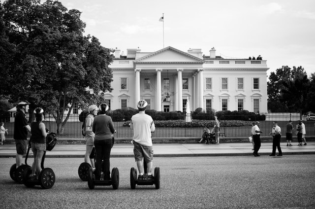 Tourists on Segways in front of the White House.