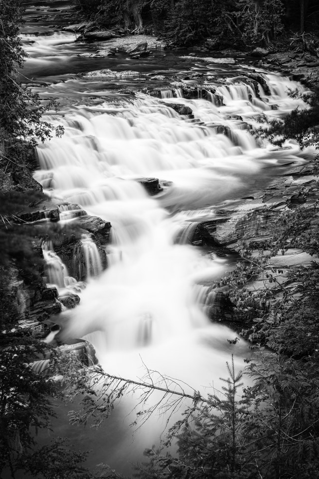 A long exposure photograph of McDonald Falls, as seen from the turnout on Going-to-the-Sun Road.