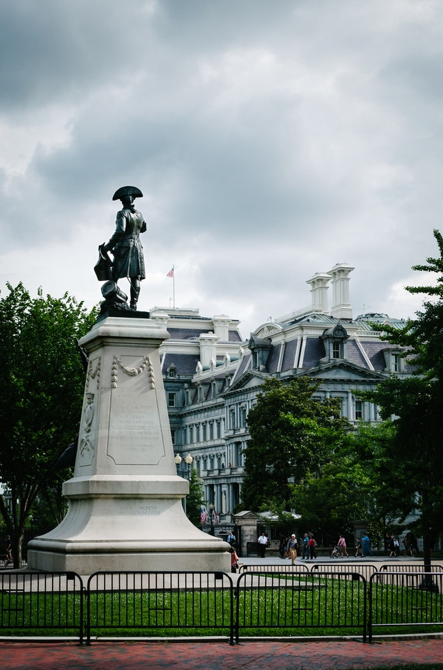 Statue of General Rochambeau at Lafayette Park in Washington, DC, with the Old Executive Office Building in the background.