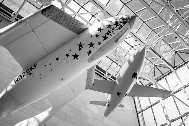 "SpaceShipOne and the Bell X-1 ""Glamorous Glennis"", at the National Air and Space Museum's Milestones of Flight hall in Washington, DC."
