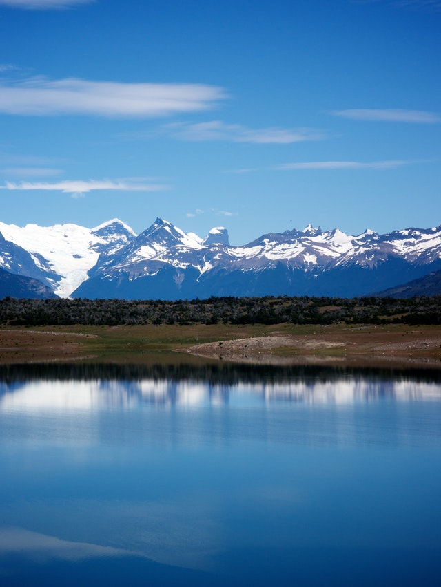 Sky and mountains reflecting off the Lago Roca in Argentina.