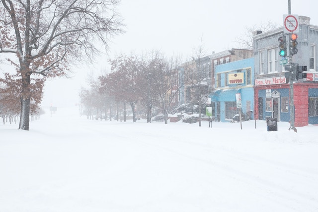 The corner of Pennsylvania Avenue and 15th Street SE, completely covered in snow.