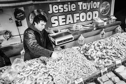 A man packing shrimp for sale at the Maine Avenue Fish Market in Washington, DC.