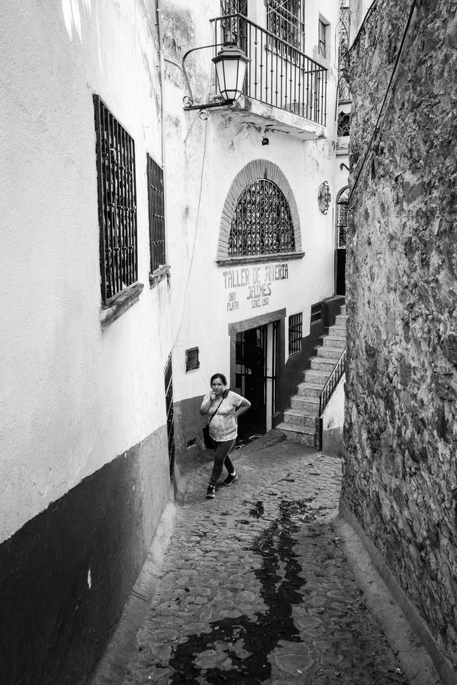 A woman walking in an alley in Taxco.