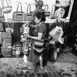 A woman selling baskets and handbags on the street in Taxco.