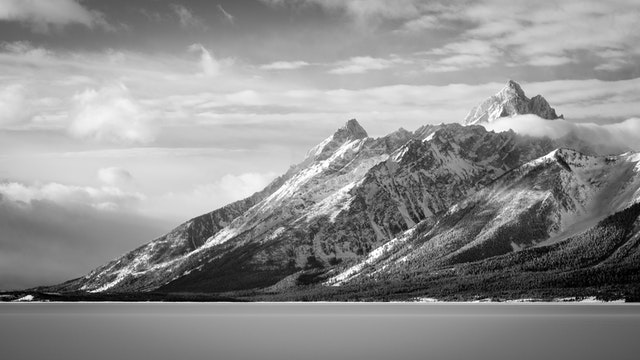 The Teton Range, seen early on a cloudy winter morning from the Jackson Lake Overlook.