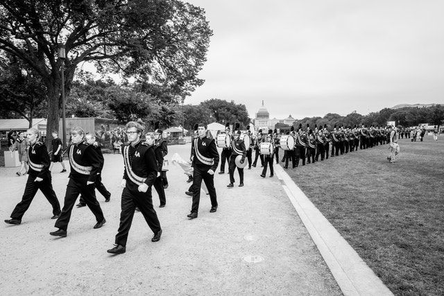 A marching band marching on the National Mall.
