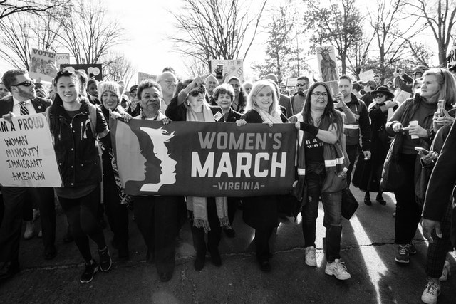 Nancy Pelosi marching with protesters at the Women's March in Washington, DC.
